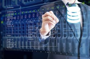Double exposure of professional businessman system analysis design and drawing database table with server storage technology background